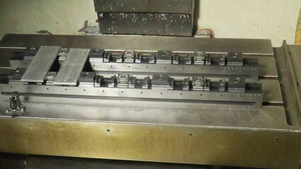 Multi-Rail system clamps typically 6 to 12 workpieces at a time